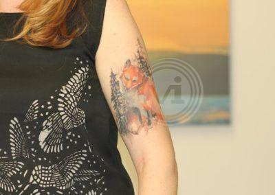 New-coloured-fox-tattoo-over-old black-tattoo