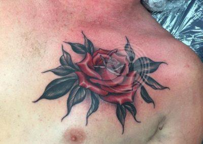 New-coloured-rose-chest-tattoo-after-cover-up